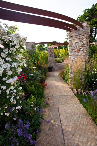 Contemporary pathway with vibrant planting
