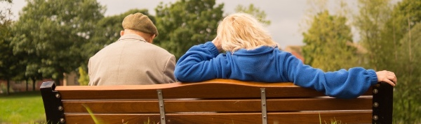An image of a couple sitting on a bench used on the Lynden Consulting Ltd website, a strategic marketing and communications company founded by Edna Petzen, Chartered Marketer and PR professional