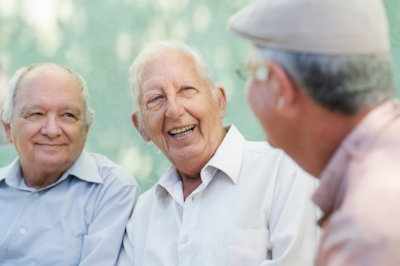 An image of three old men smiling used on the Lynden Consulting Ltd website, a strategic marketing and communications company founded by Edna Petzen to help health and adult social care organisations to improve their marketing and communications planning, sales and marketing and business performance