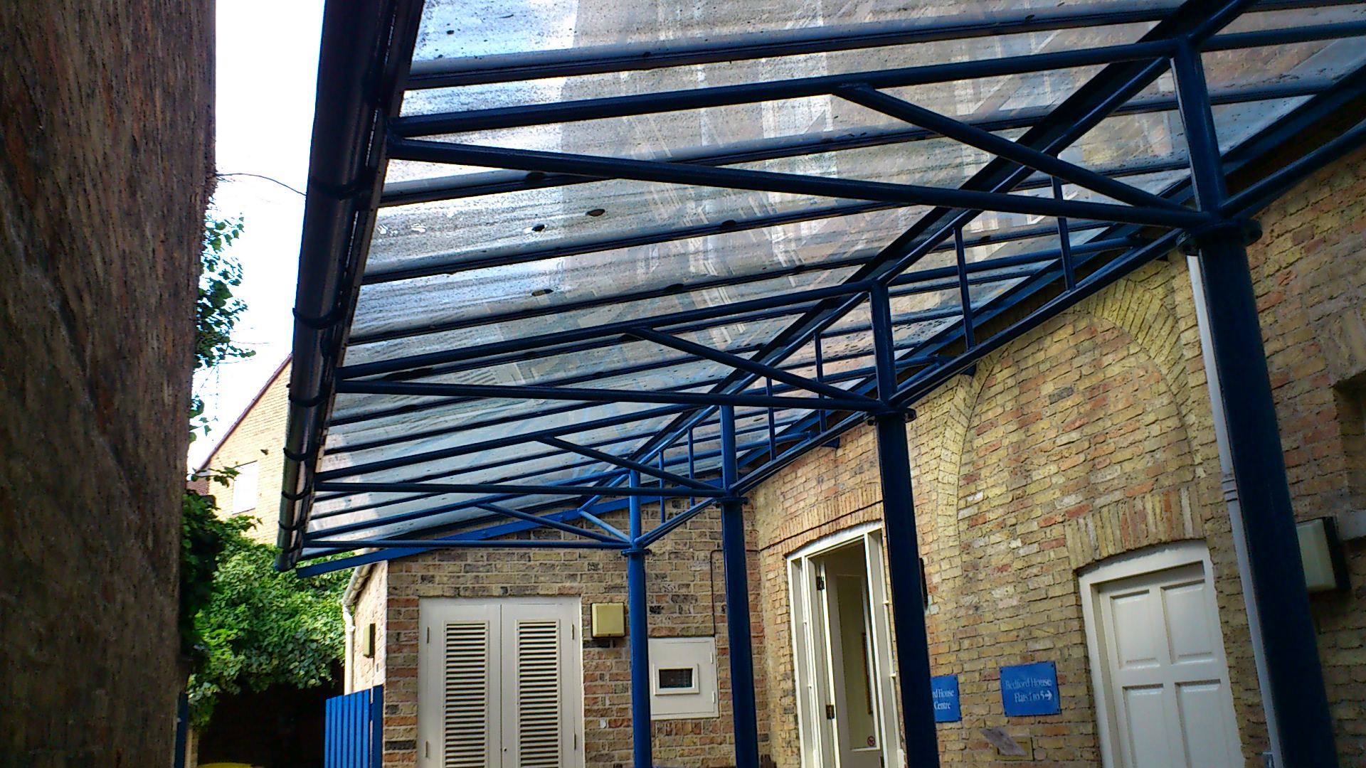 Glass entrance canopy cleaning - (Before).