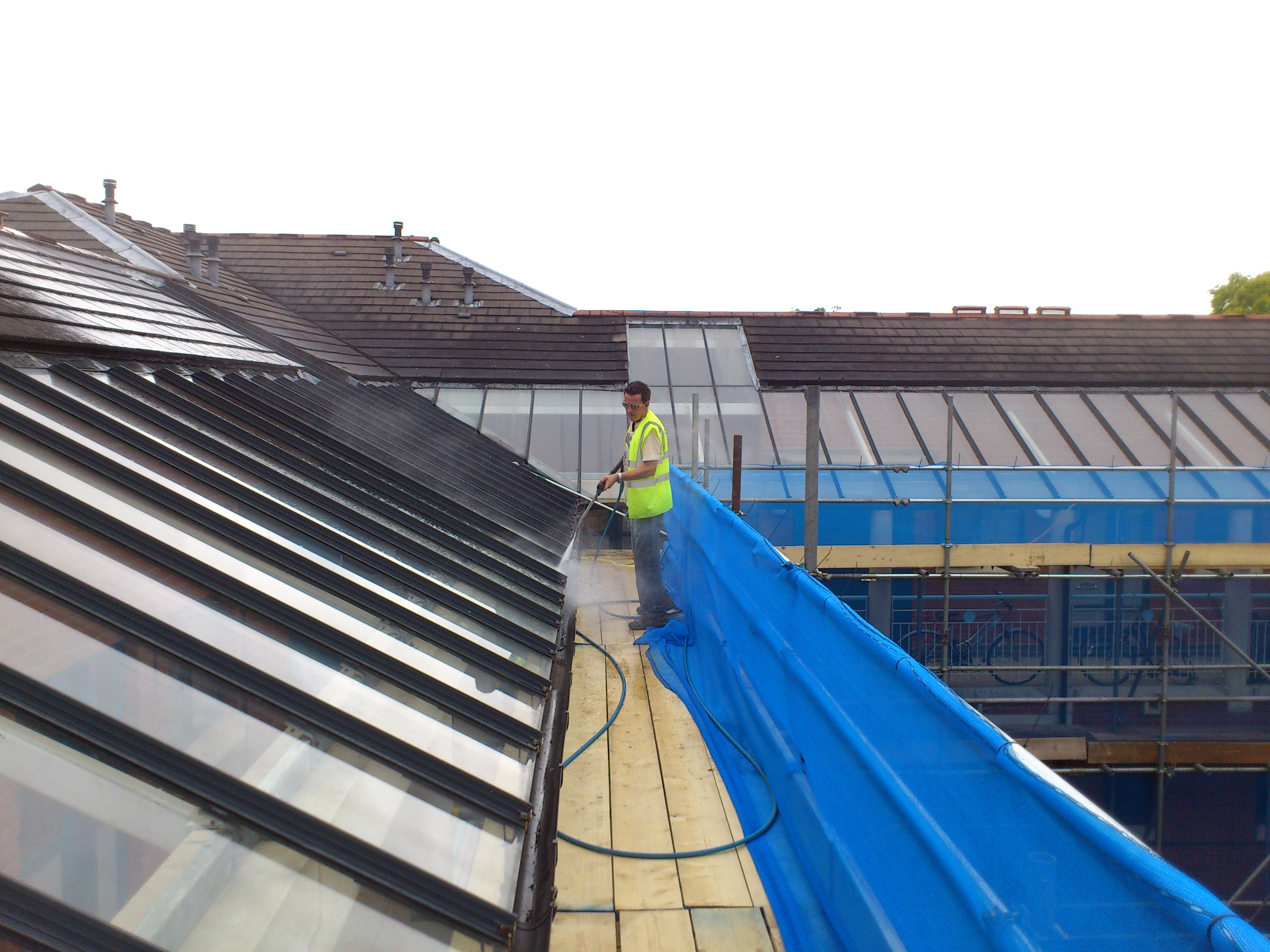 Steam cleaning / pressure washing of high level  glass roof in Cambridge.