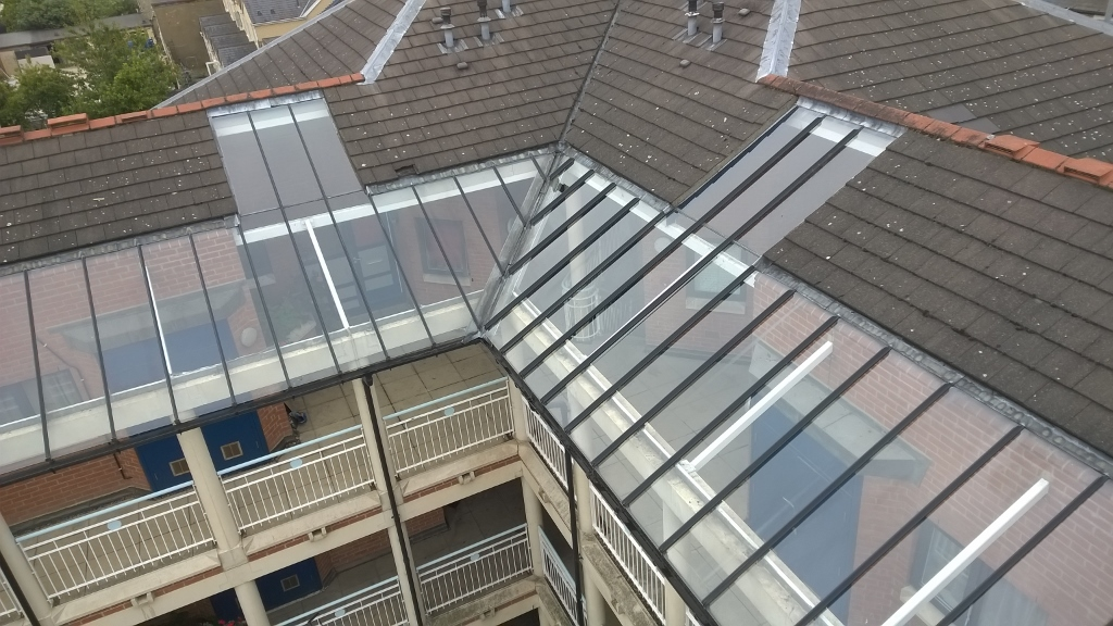 High level glass canopy clean in Cambridge - accessed by cherry picker