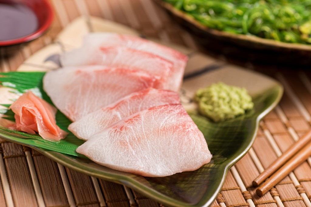 Sashimi is thin slices of raw food and is one of the most famous dishes in the Japanese cuisine. Depending on the type of sashimi wasabi can be added on the side. This set up allows for dabbing the wasabi directly onto the pieces of sashimi before eating.