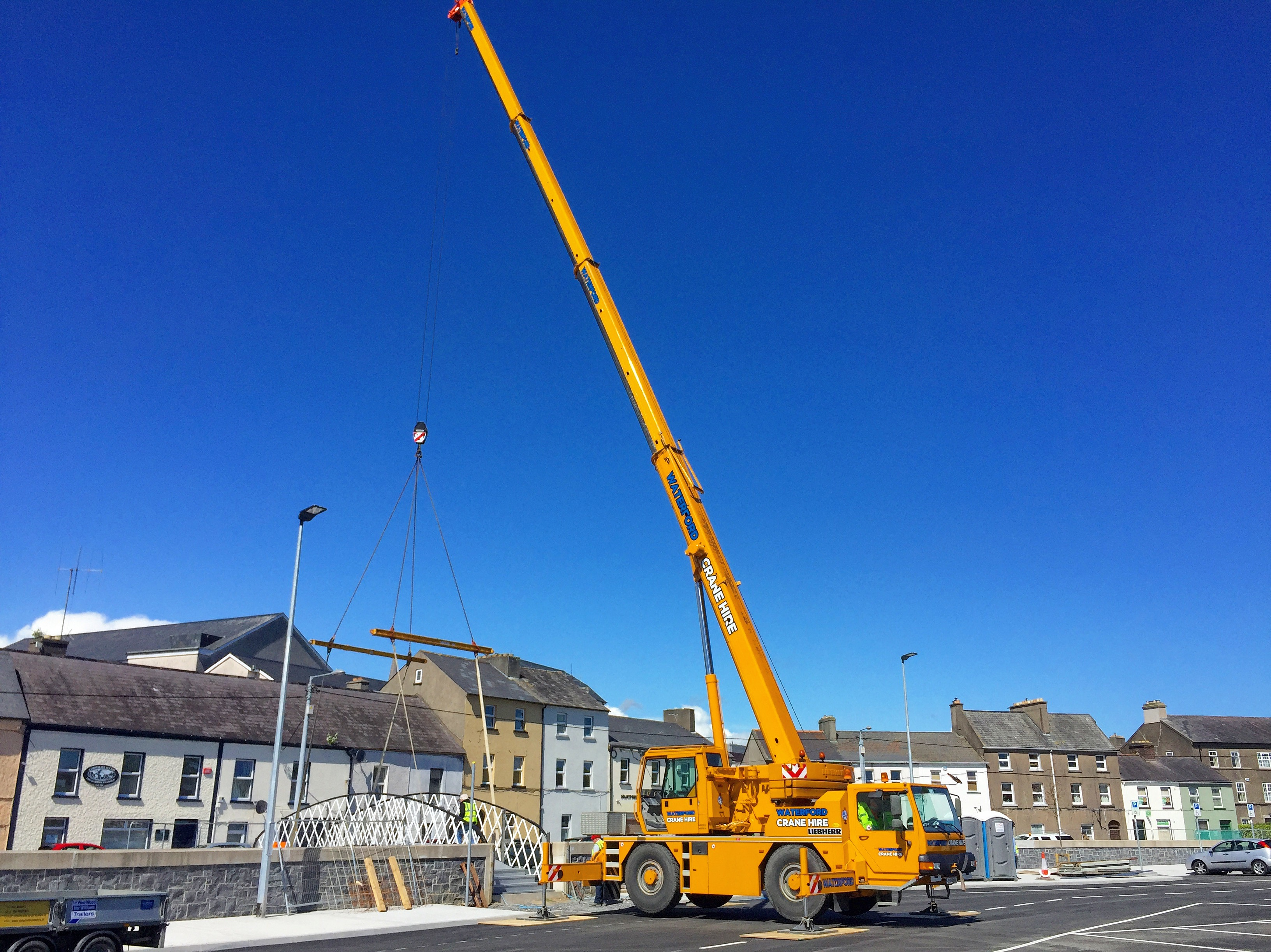 Installing a restored 140 year old footbridge with use of spreader beams in Waterford City