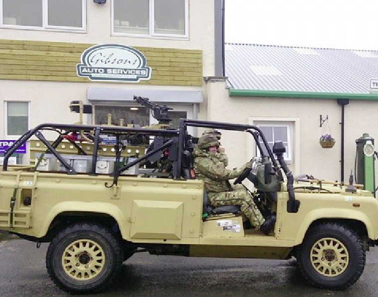 A military Defender armoured car at Gibsons Auto Services Cumnock