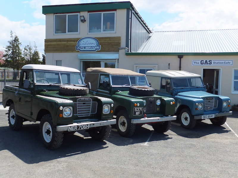 Land Rover specialists Gibsons Auto Specialists Cumnock Ayrshire, displaying a row of four old-style Land Rovers