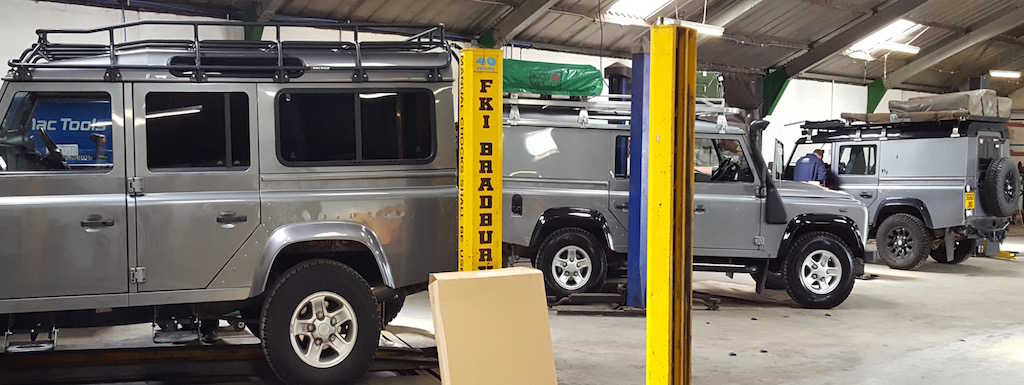 Land Rover Defenders in the Gibsons Auto Services workshop in Cumnock Ayrshire