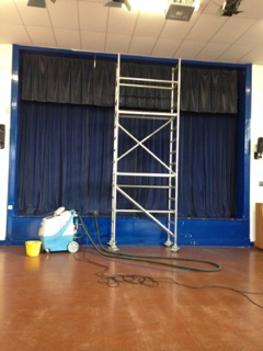This is an example of school stage set of curtains being cleaned. Bottom half completed.Tophalf left