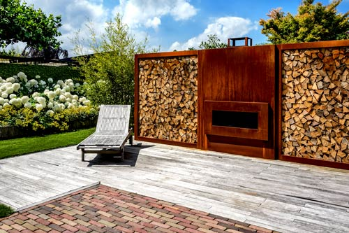 Modern garden with wood storage and corten steel fire place