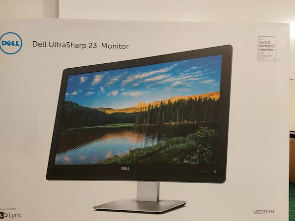 "New Dell UltraSharp 23"" conference monitor."