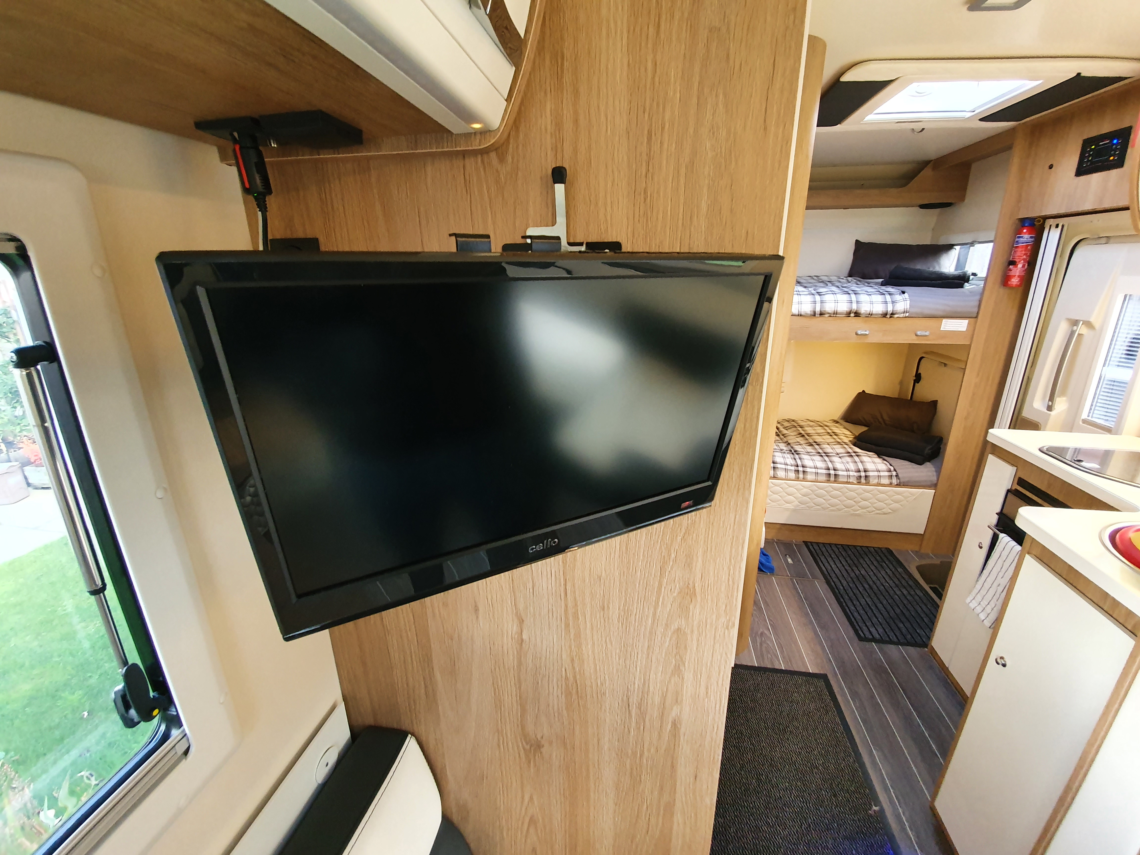 Image of TV & DVD player located in the main lounge area of the motorhome