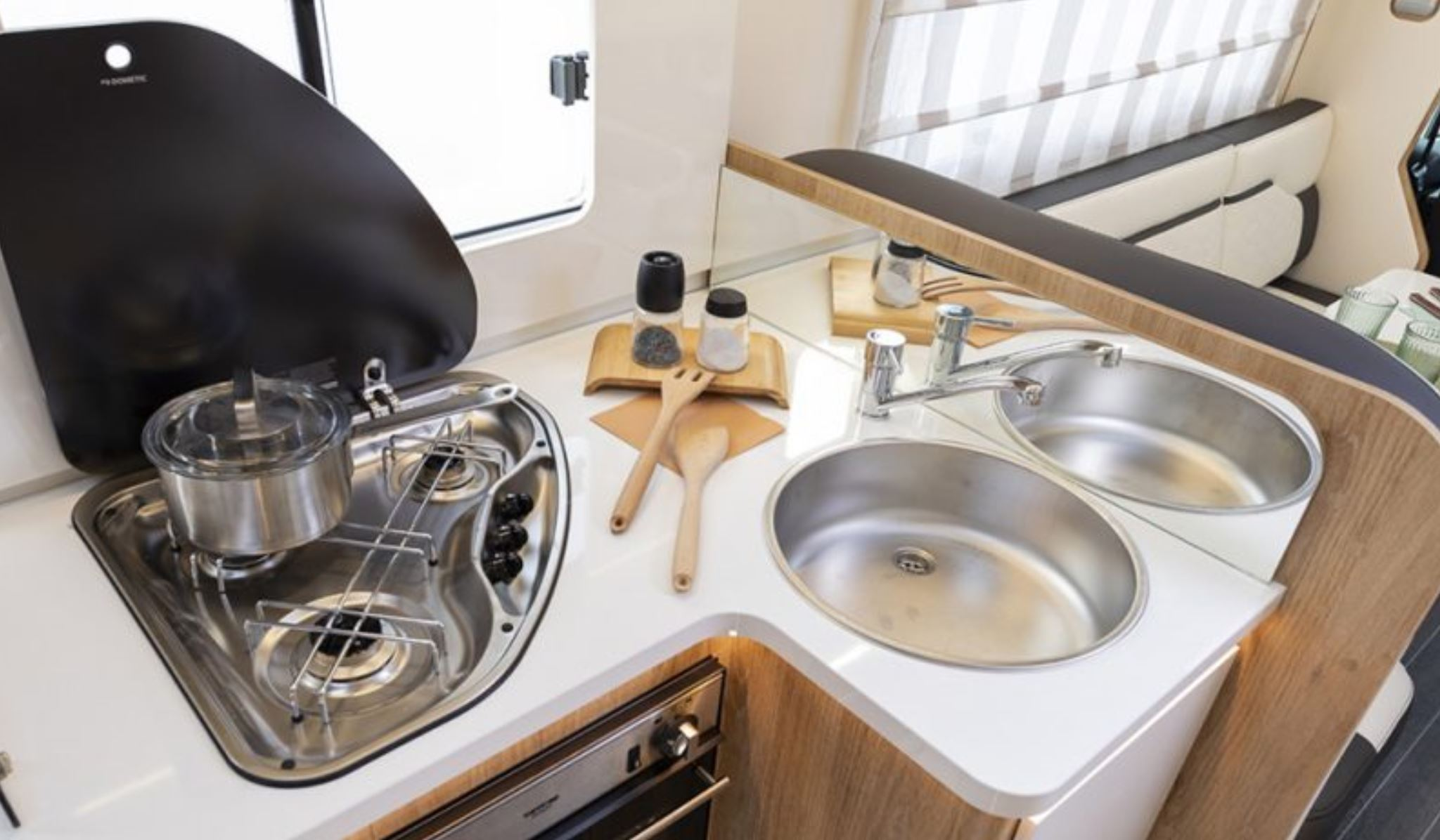 Image of kitchen cooking area including hob, oven and sink