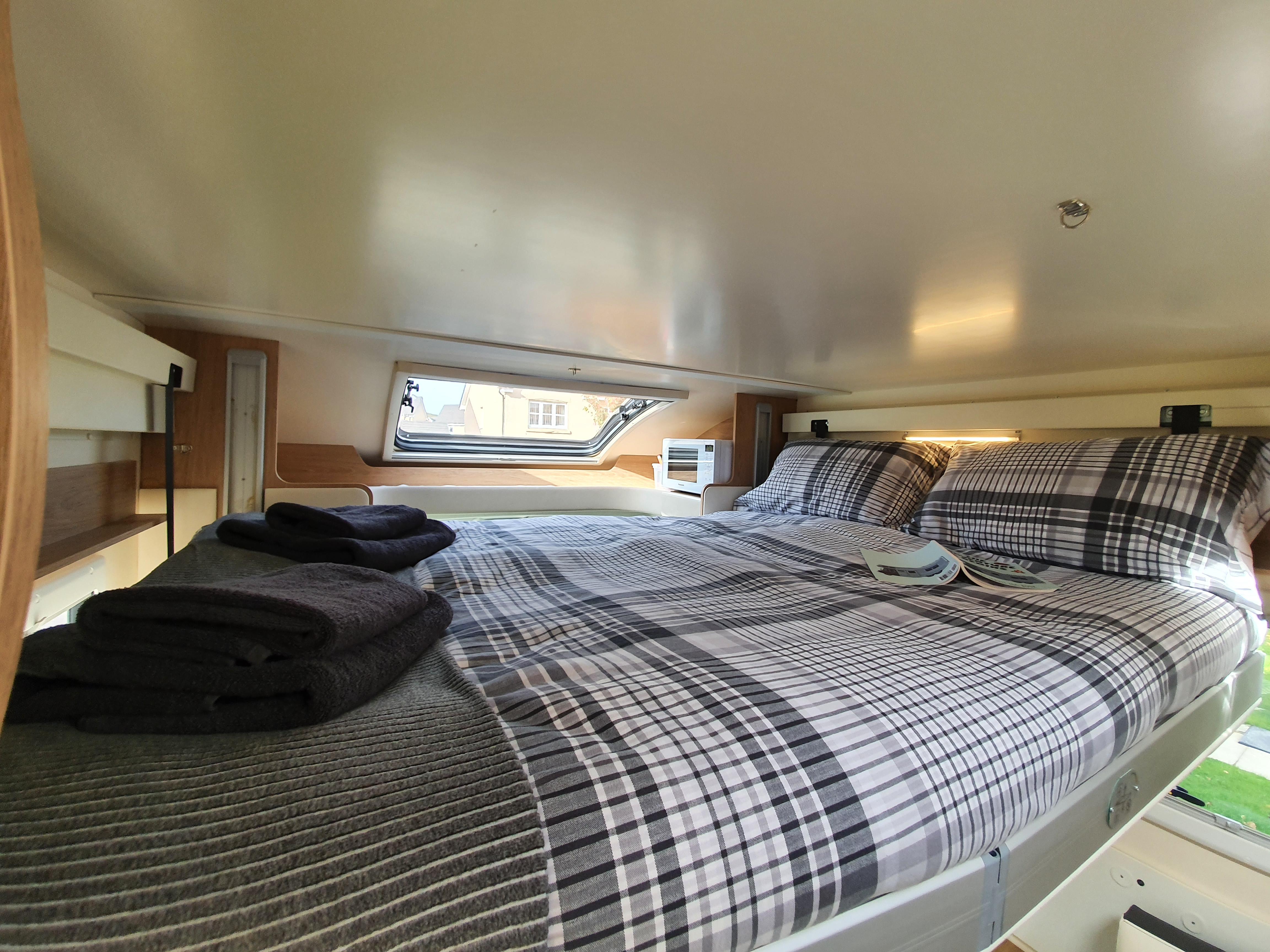 Image of electric drop down double bed over main lounge area