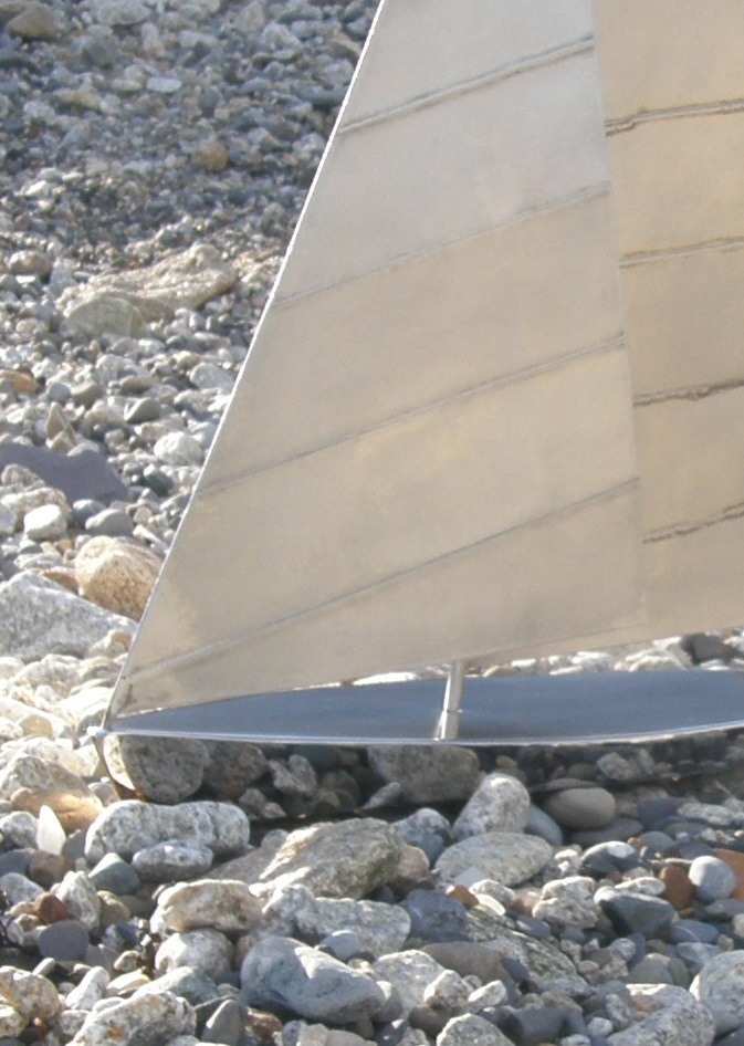 Close up view of highly polished hull & sail detail