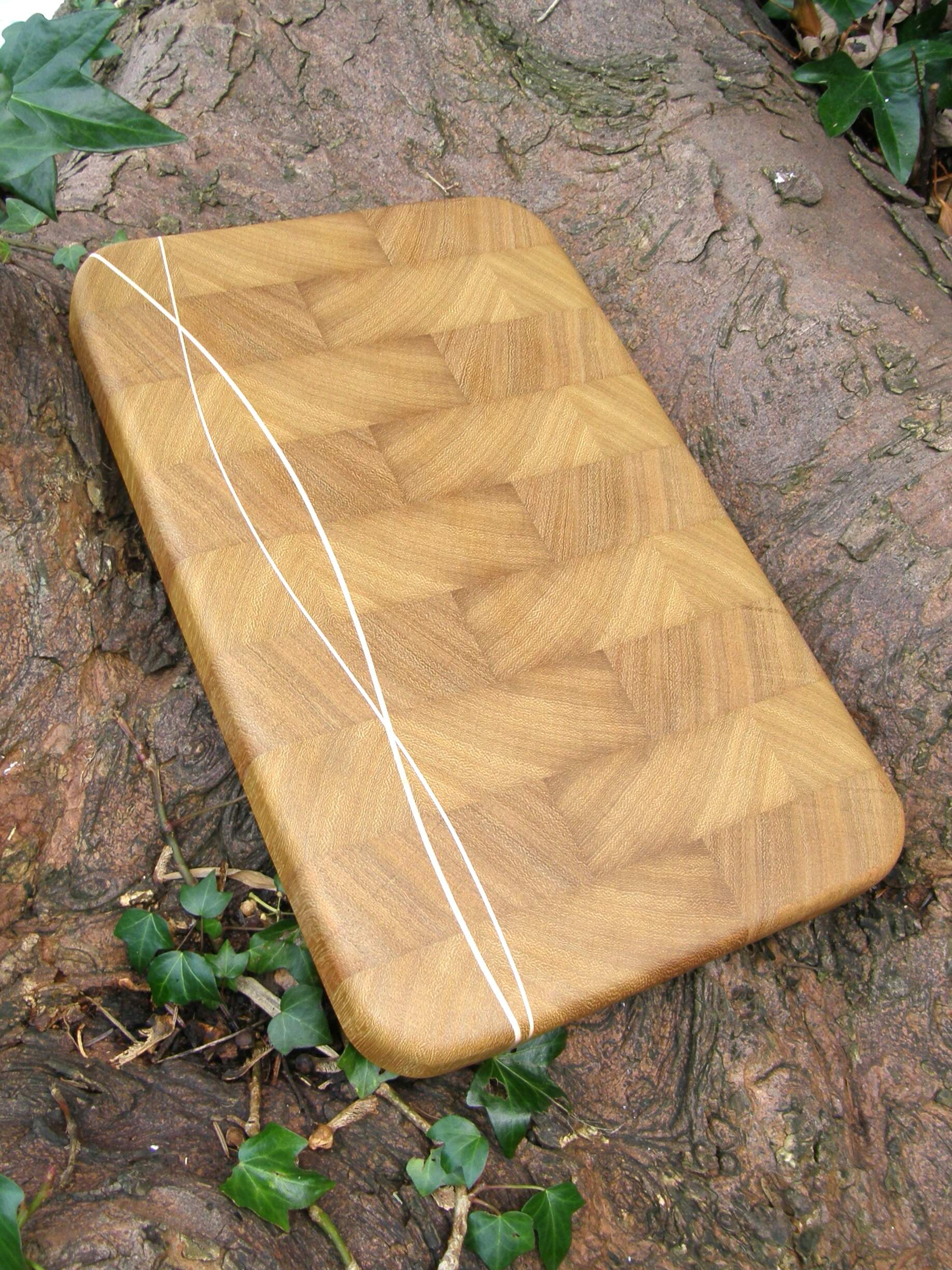 End Grain Chopping Board Handmade in Iroko with Maple Wave Inlay.
