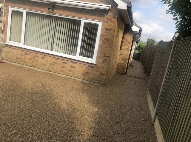 Pathway around house is now neat and tidy in a golden resin bound surface