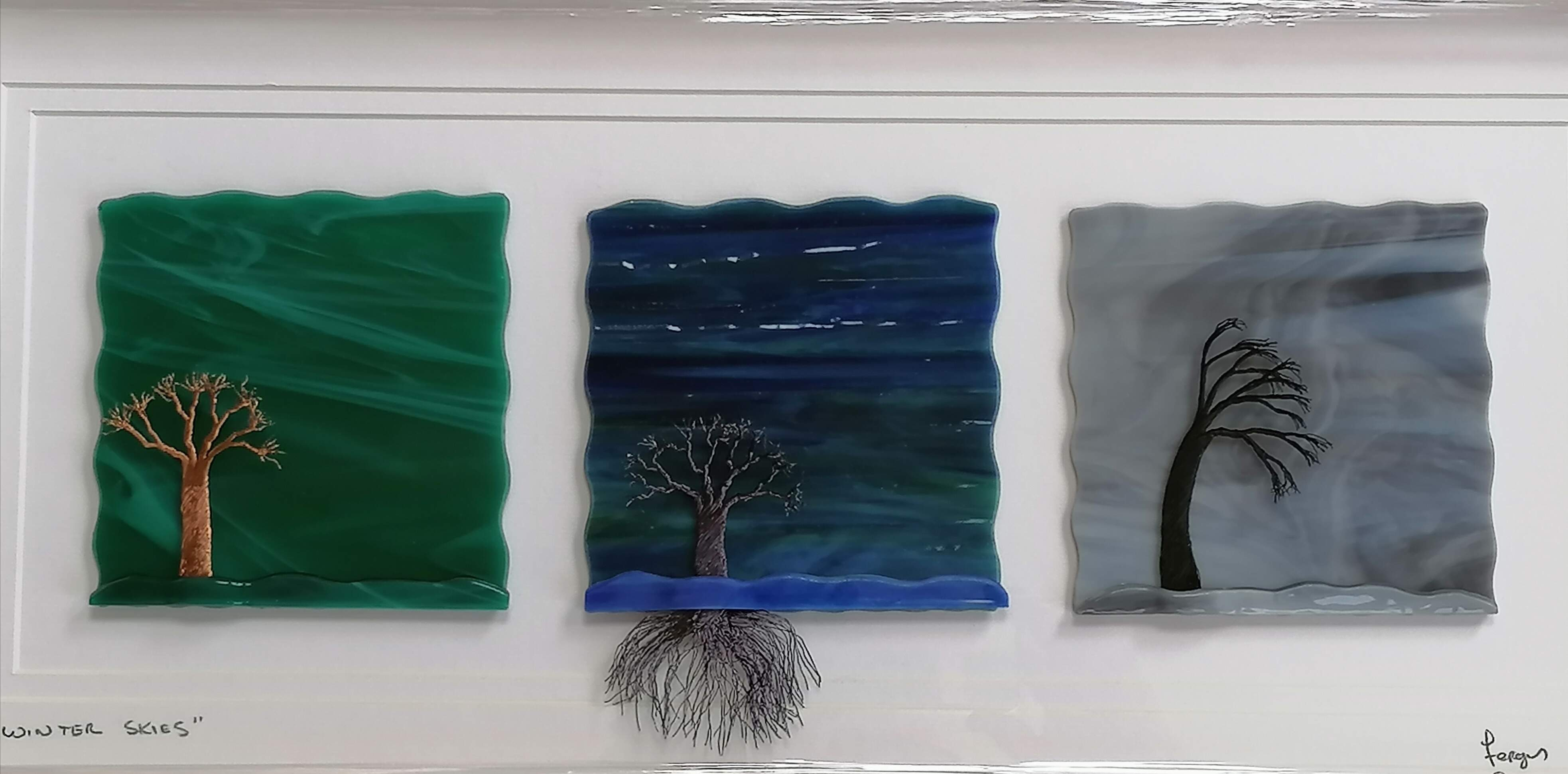 3 panels of Glass Art, with handmade copper wire Trees, finished in a white wooden frame.