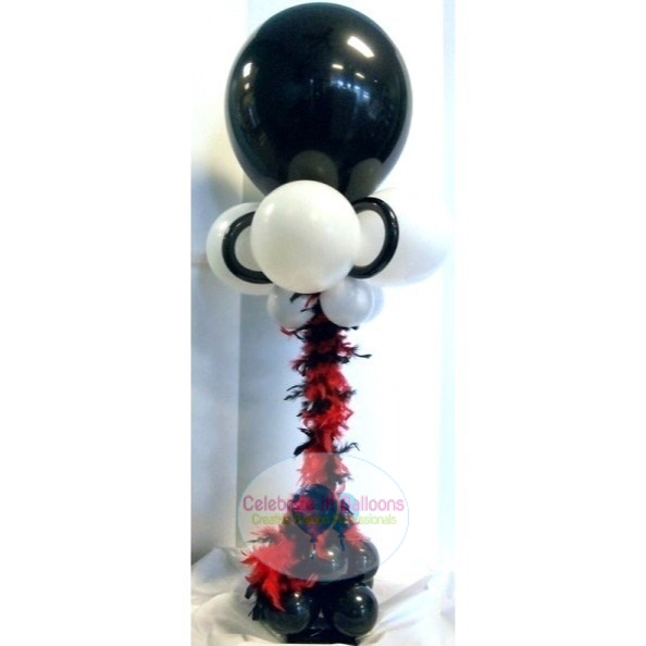 Fancy balloon centerpiece on stand with feather boa in red, black and white