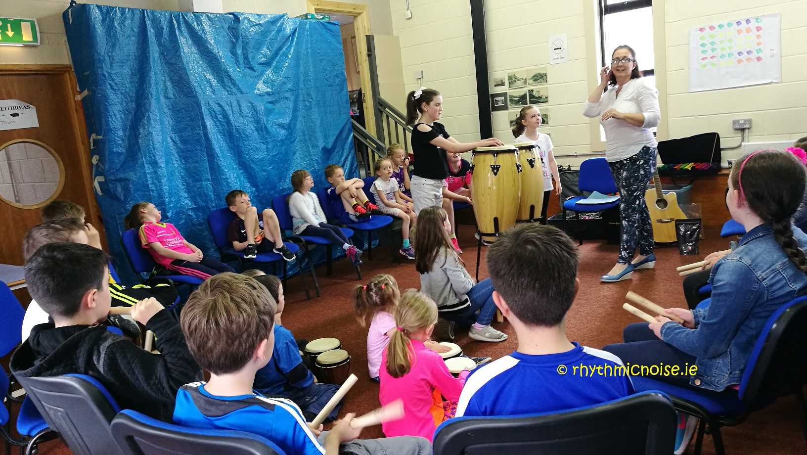 workshop; group; primary; students; demonstration; music; ear training; rhythm; percussion; Donegal; focused; teamwork; fun
