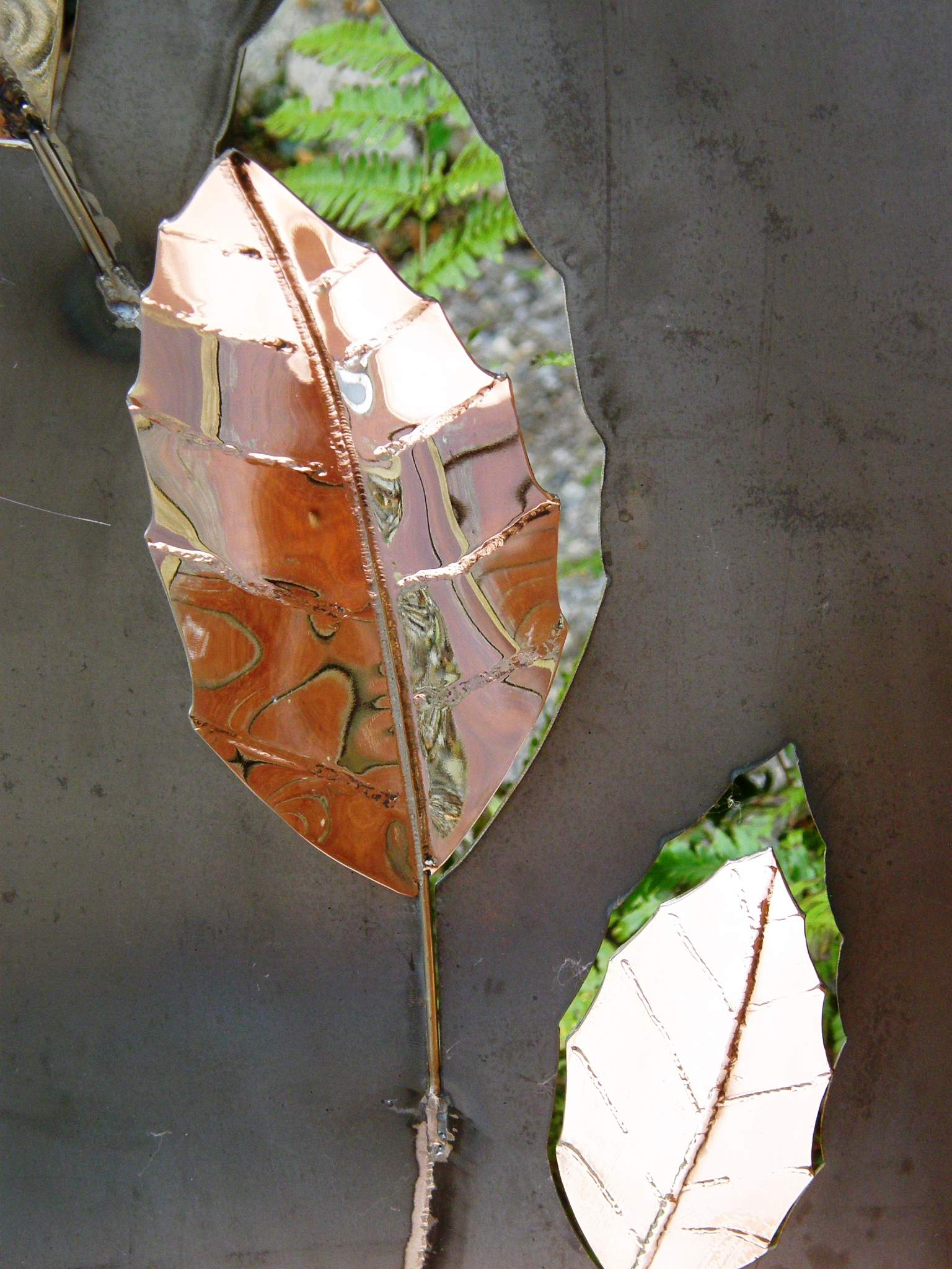 Copper reflections in Stainless Steel Leaves