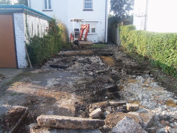 Old driveway being broken up in Byfleet by Block Paving Surrey