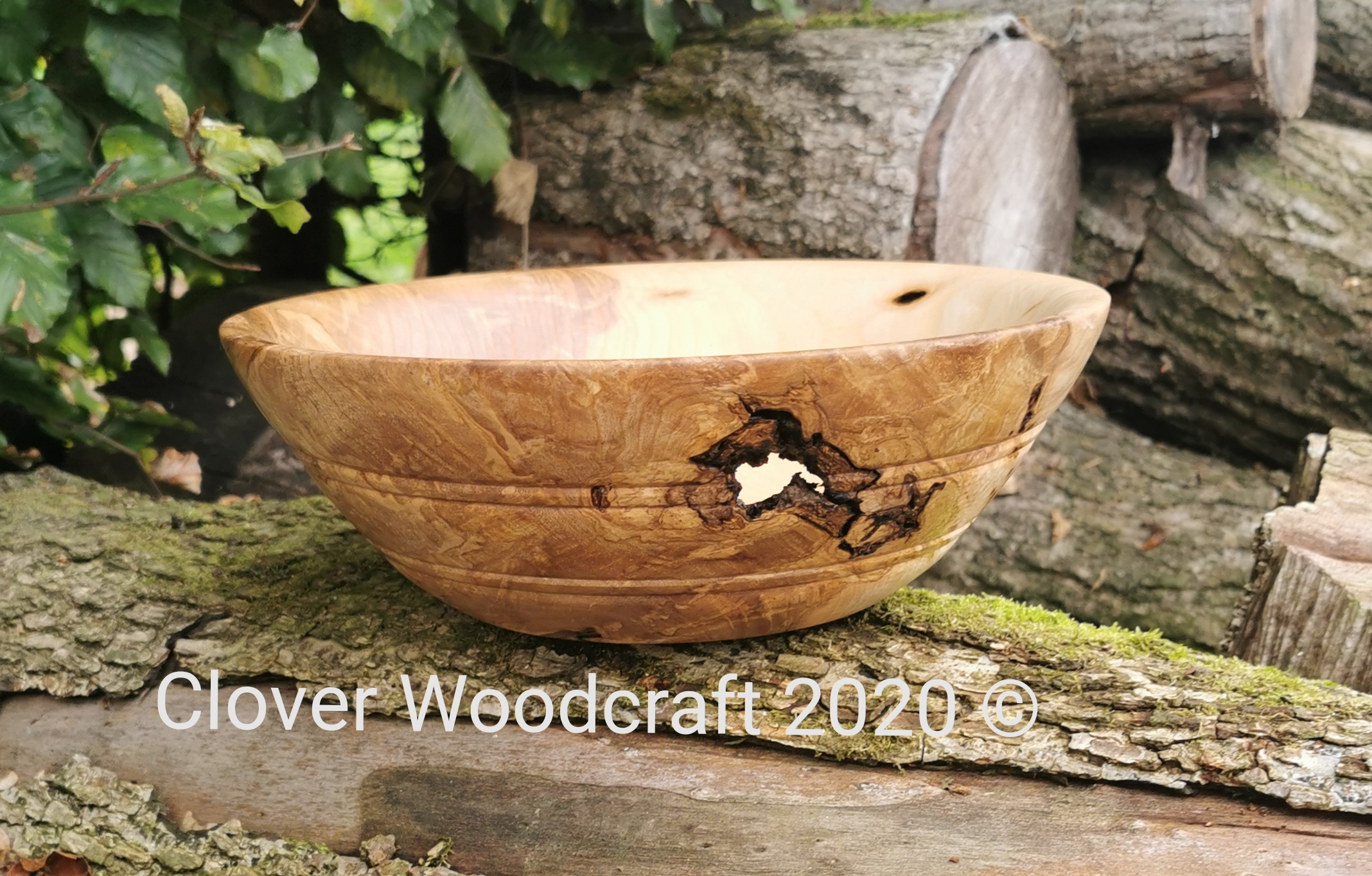 Irish Ash Wood Turned Salad Bowl featuring Natural Voids and Bark Inclusions.