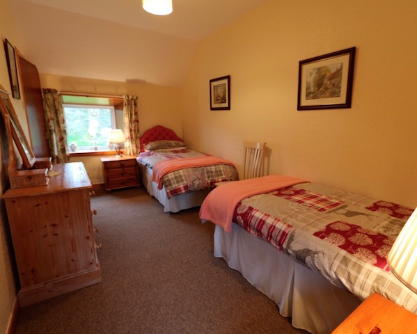 A guest bedroom at the self catering holiday cottage East Challoch Farm