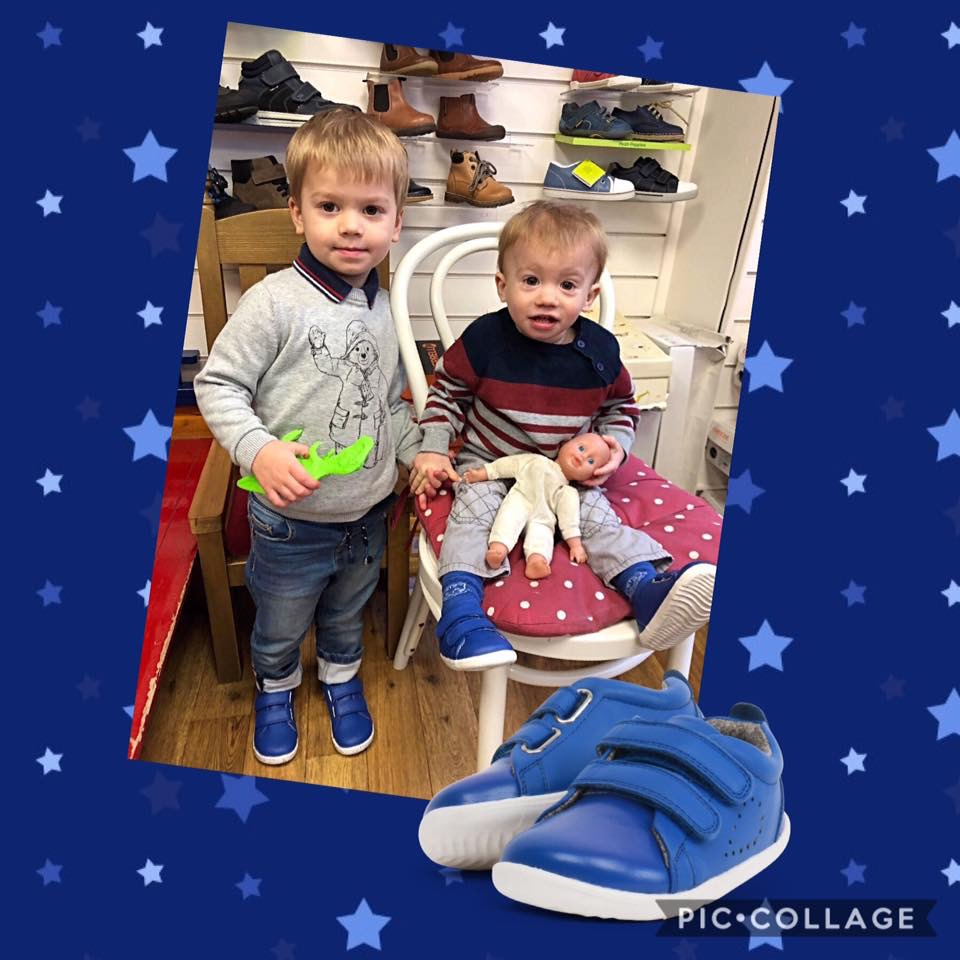 Happy little boy customers at The Pied Piper shoe shop in Dumfries