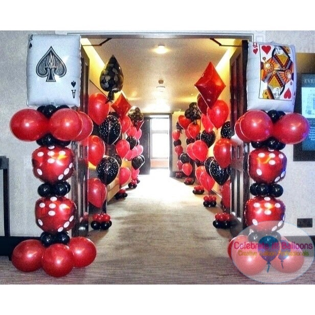 Casino theme balloon columns with jumbo playing card balloon and dice
